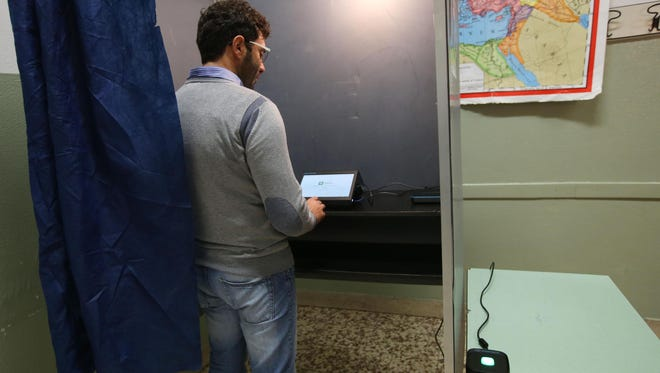 A man votes in the  referendum on the autonomy of Lombardia and Veneto regions of Italy in Brescia on Oct. 22, 2017.