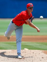Georgia pitcher Emerson Hancock throws a pitch during the first inning against Mississippi in an NCAA college baseball game at the Southeastern Conference tournament, Saturday, May 25, 2019, in Hoover, Ala. (AP Photo/Butch Dill)