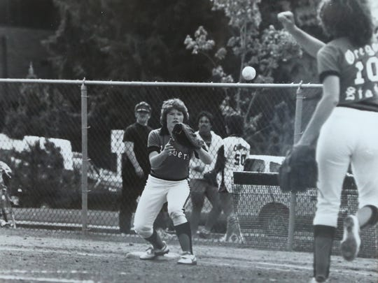 In this image from 1983, Colleen Henery plays first base for Oregon State University.