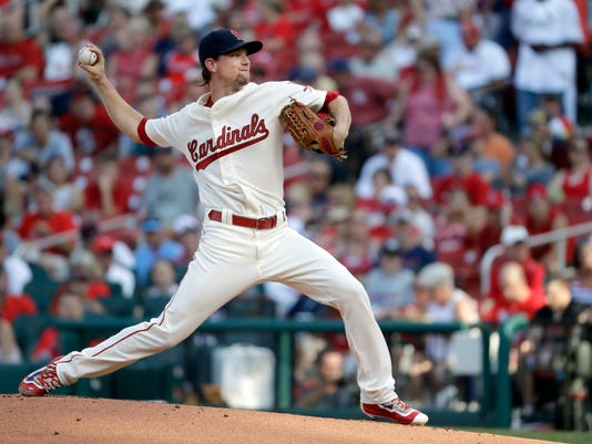 St. Louis Cardinals starting pitcher Mike Leake throws during the first inning of a baseball game against the Los Angeles Dodgers on Saturday, July 23, 2016, in St. Louis. (AP Photo/Jeff Roberson)