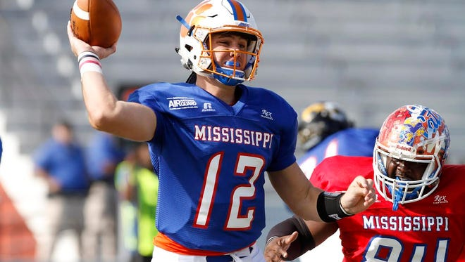 North quarterback Jack Walker of Madison Central feels pressure from the South's Dennis Stevenson of Gulfport during the Bernard Blackwell All-Star Classic on, Saturday.