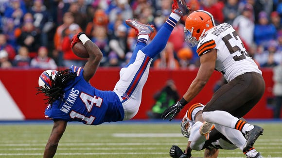 Bills wide receiver Sammy Watkins (14) carries the ball as Cleveland Browns cornerback Buster Skrine (22) and inside linebacker Craig Robertson (53) defend during the second half on Nov. 30 at Ralph Wilson Stadium.