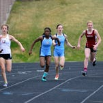 Great Falls High's Hannah Collins takes the baton from Alyssa Jonasen in the 400 relay during Saturday's track meet at Memorial Stadium.
