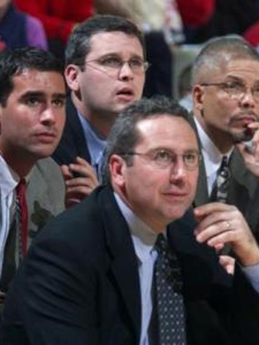 Dan Hurley (top, from his Rutgers coaching days) won't be coming back to the area.
