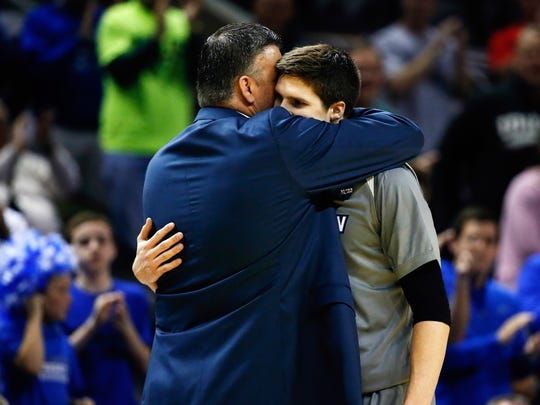 FILE - Creighton Bluejays head coach Greg McDermott embraces forward Doug McDermott (3) after they lost to the Baylor Bears in a men's college basketball game during the third round of the 2014 NCAA Tournament at AT&T Center.