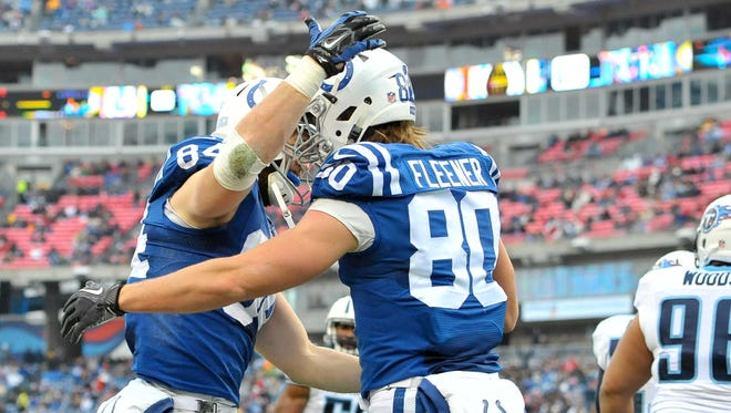 Indianapolis Colts tight end Jack Doyle (84) celebrates scoring a touchdown against Tennessee Titans with teammate Indianapolis tight end Coby Fleener (80) during the first half at LP Field.