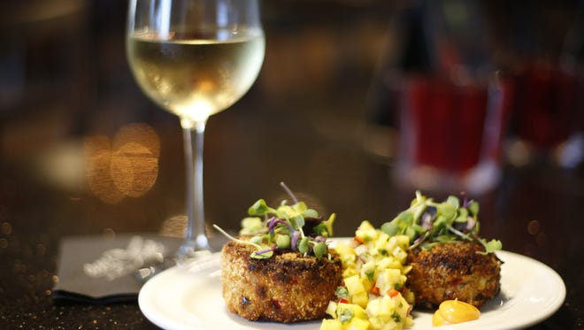 101 Restaurant's crab cakes, sauteed jumbo lump crab cakes served with tropical pineapple mango salsa with a smoked paprika aioli.