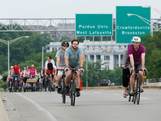 Cyclists pedal across the Harrison Bridge from West