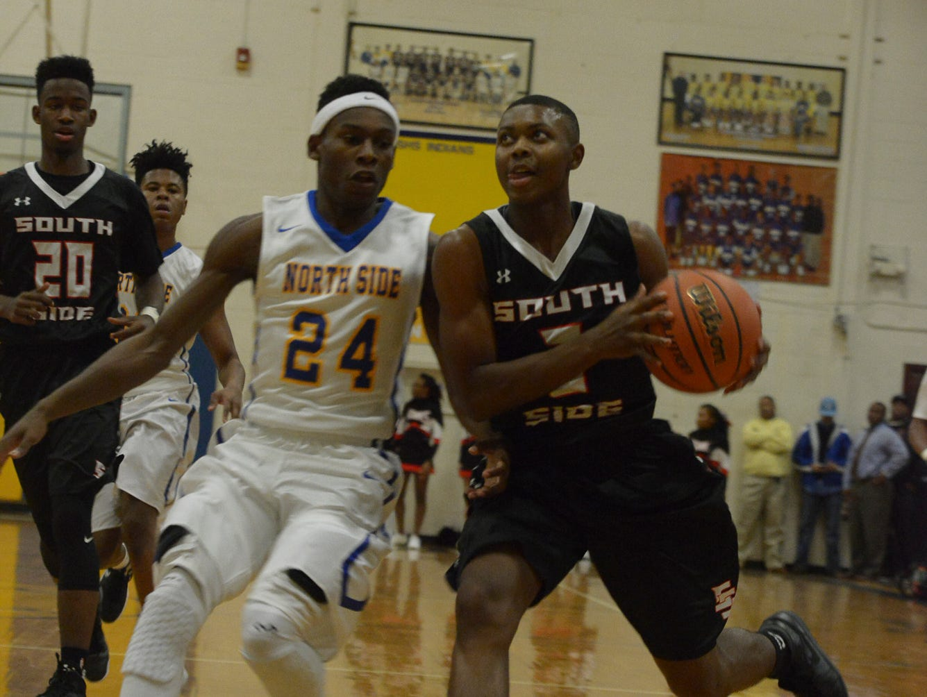 The Indians of North Side High School hosted the Hawks of South Side High School, Tuesday, November 24, 2015 at North Side. The Hawks defeated the Indians, 87-52.