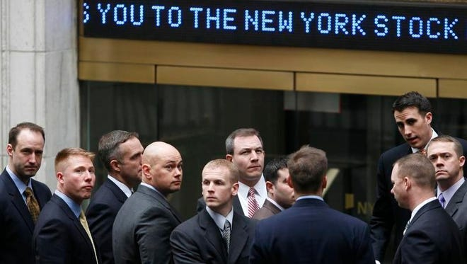 In this March 9, 2009, file photo, businessmen arrive at the New York Stock Exchange in New York. It was on March 9, 2009, that stocks finally hit bottom in the financial crisis, after the Standard & Poor's 500 index lost 55 percent in 17 months and gutted retirement and other investment accounts. The next day, the S&P 500 perked up by 6.4 percent, and it's been racing higher ever since thanks to extraordinary stimulus from the Federal Reserve and a recovery in corporate profits, with only a few interruptions in between.