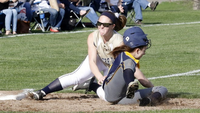 Notre Dame third baseman Mackenzie Maloney tags out Tioga's Alex Divers on Friday during the Crusaders' 11-2 victory in Southport.