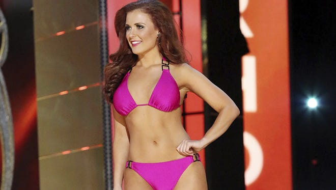 Miss Rhode Island Ivy DePew contestant walks the runway during the swimsuit portion of the preliminary first night of the Miss America pageant at Boardwalk Hall in Atlantic City, N.J., Tuesday, Sept 9, 2014.