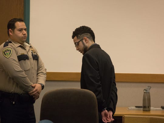Rafael Cervantes,19, is lead out of the courtroom a