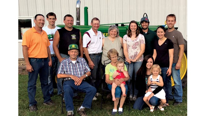 Brown County Farm Family of the Year, the Rosenhammer family, gathered for a picture at their farm. Seated in front, from left, are Dennis and Mildred Rosenhammer, Mildred is holding great-granddaughter Morgan Scholtz and Rebecca Rosenhammer holding Ava Fischer. Standing are Greg Rosenhammer, Johnny Rosenhammer, Joe Rosenhammer, John and Patty Rosenhammer, Mary and Kyle Fischer, and Laura and Chris Scholtz.