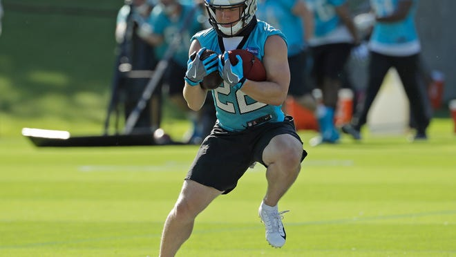 Carolina Panthers' Christian McCaffrey (22) runs a drill during the NFL football team's practice in Charlotte, N.C., Monday, June 4, 2018. (AP Photo/Chuck Burton)