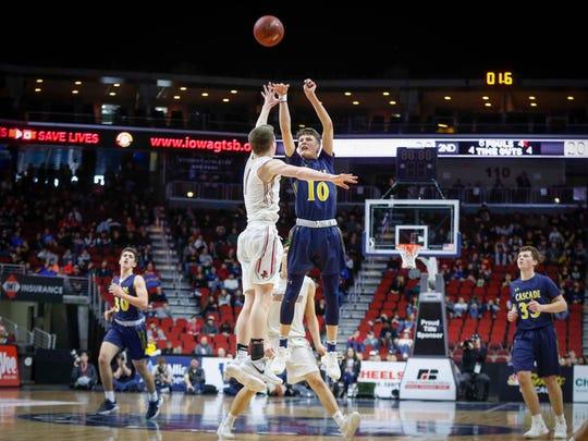 Cascade senior Brock Simon launches a shot against