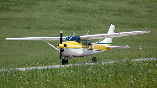 In this June 2011 photo provided by the Vermont Agency of Transportation, the state's 1960 Cessna single-engine airplane used to transport the governor taxis on a runway at the Caledonia County Airport in Lyndonville, Vt. Gov. Peter Shumlin regularly flies in the 56-year-old plane after he moved in 2016, his last year in office, from East Montpelier back to his home area in southern Vermont. (Dan Freeto/Vermont Agency of Transportation via AP)