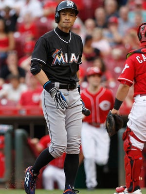 Miami Marlins right fielder Ichiro Suzuki walks from the plate after striking out during the second inning against the Cincinnati Reds at Great American Ball Park.