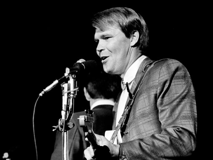 "Glen Campbell sings ""By the Time I Get to Phoenix"" at the Capitol Records pizza party and show Oct. 21, 1967, at Municipal Auditorium."