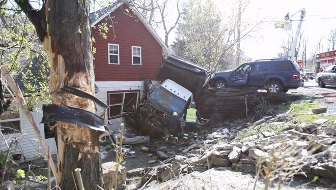 A dump truck hit a tree, a wall and then crashed into this home and an SUV in Big Flats Wednesday afternoon.