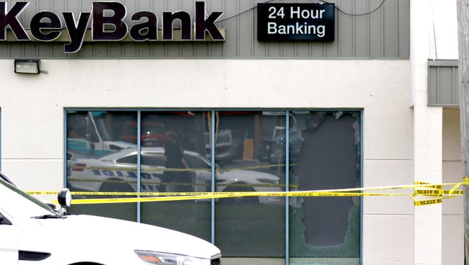 Gunfire erupted during an alleged robbery attempt at a Key Bank in Colerain Township Monday.