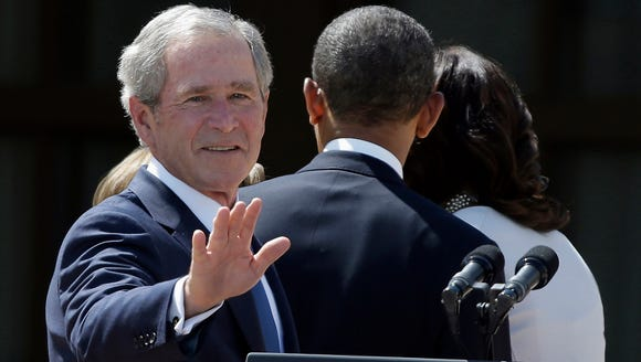 Former president George W. Bush and President Obama.