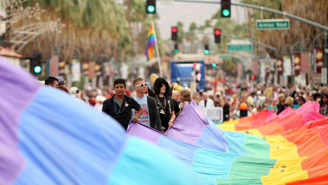 A 600-foot rainbow flag is marched down the street during the Greater Palm Springs Pride Parade.