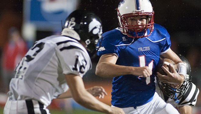 West Henderson's Peyton Frisbee, right, carries the ball against North Buncombe on Friday in Hendersonville.