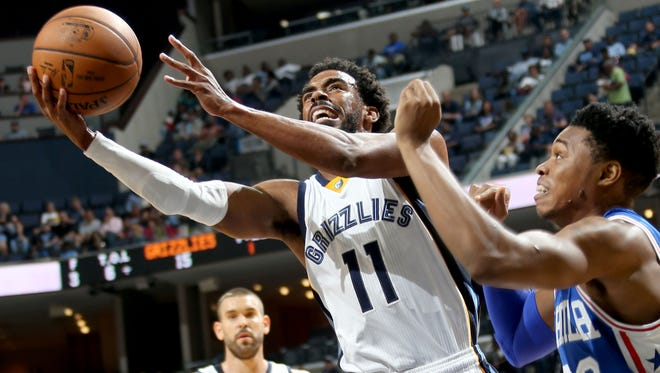 Memphis Grizzlies guard Mike Conley shoots defended by the Philadelphia 76ers' Richaun Holmes at FedExForum.