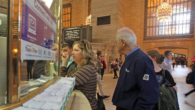 Metro North passengers go the information window for the best way to get home at Grand Central Terminal in Manhattan on May 18, 2016.