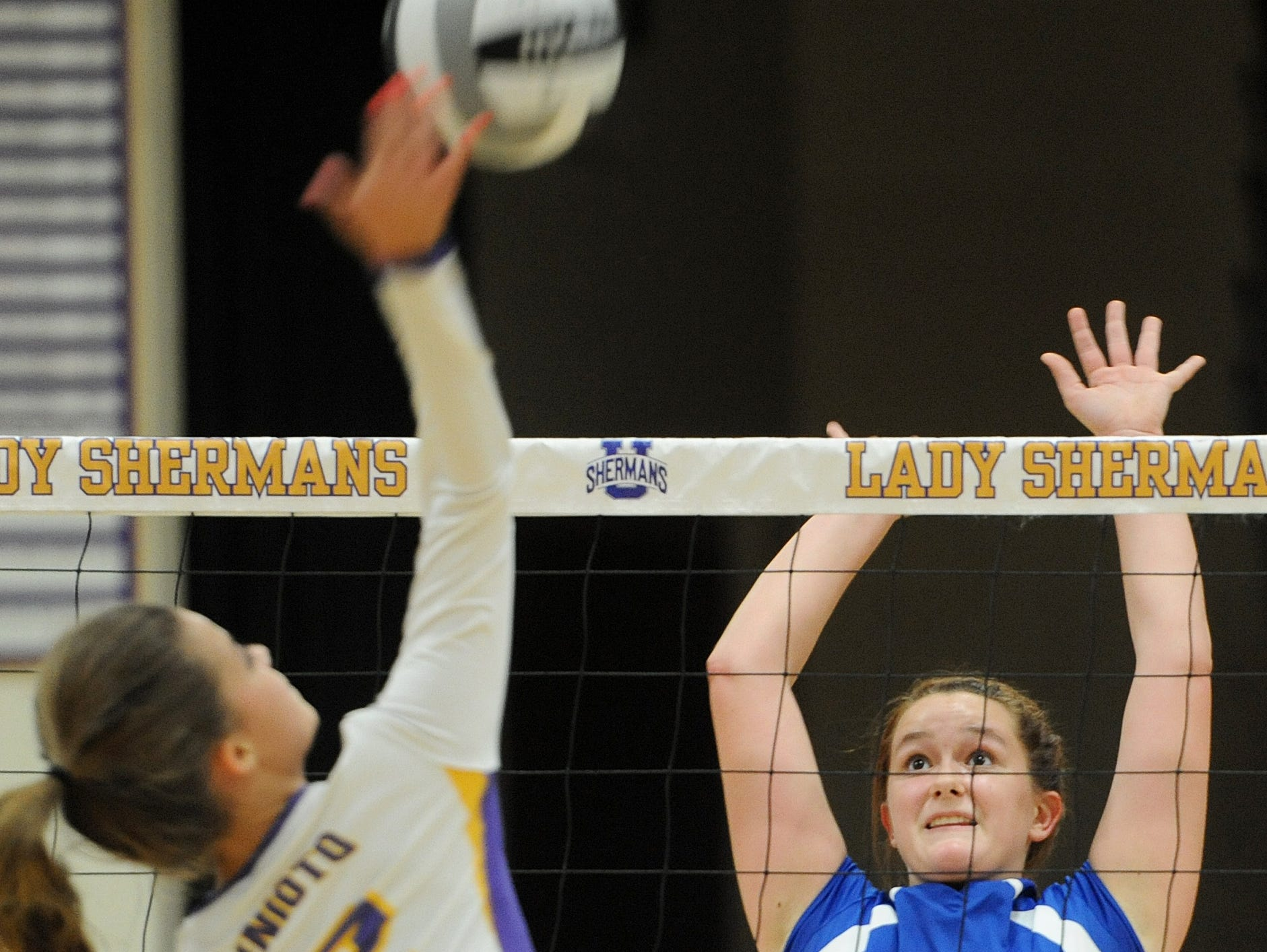 Zane Trace's Hannah Unger jumps to block the ball hit across the net by Unioto's Abbey Winegardner during the second match at Unioto on Thursday. the final score was Unioto 3, Zane Trace 0.