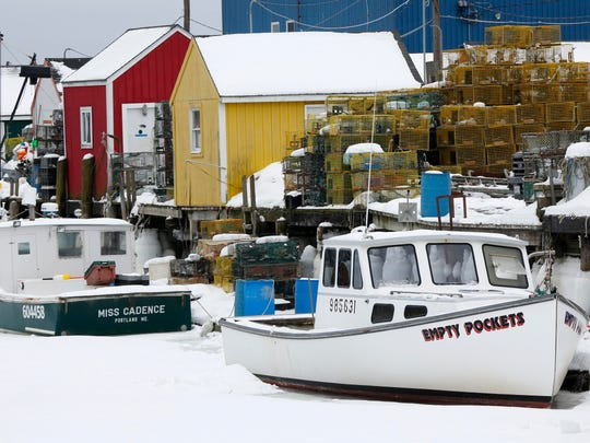 In this Feb. 26 photo, lobster fishing boats are locked in ice at Widgery Wharf in Portland, Maine.