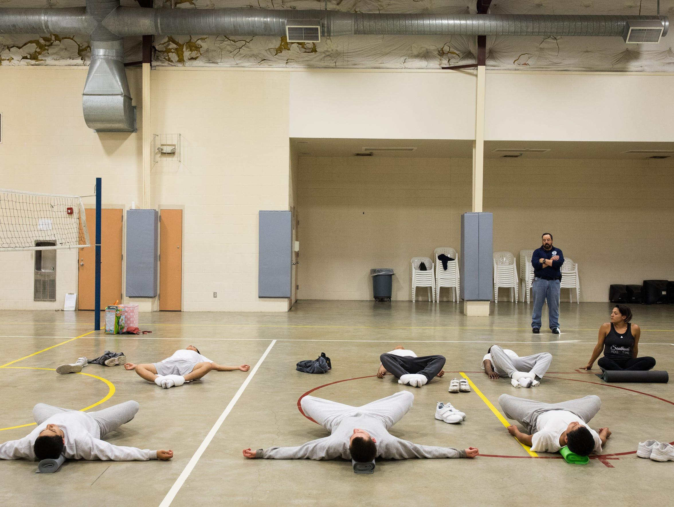 Yoga teacher Ashley Chapa leads a group of juveniles