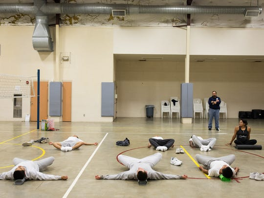 Yoga teacher Ashley Chapa leads a group of juveniles in shavasana at the end of a weekly yoga class at the Nueces County Robert N. Barnes Regional Juvenile Facility.