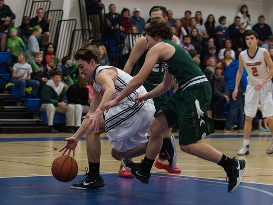 Worcester Prep's Tate Shockley (5) recovers the ball in the offensive zone during a game against the Salisbury School on Friday, Feb. 17, 2017.
