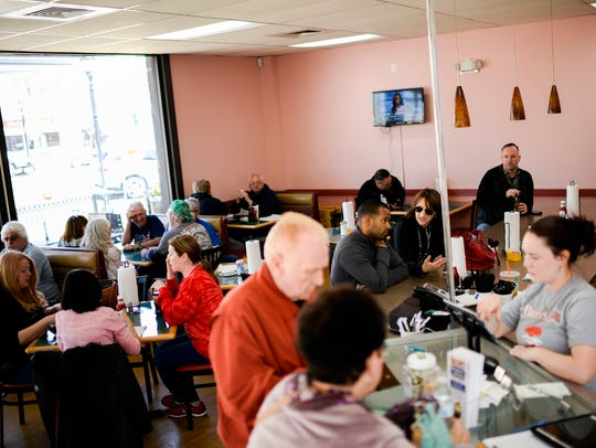 The dining room bustles at Bruni's Breakfast & Burgers
