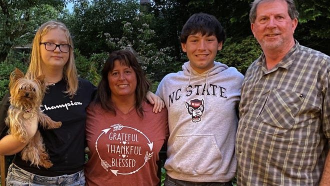Megan Edney, far left, poses with her family recently. From left to right are here mom, Lisa, her brother, Mitch and her father, Michael.