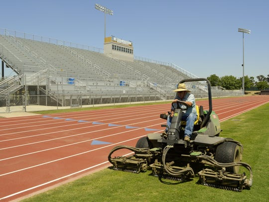 Brian Andrew, lead groundsman for Groppetti Community Stadium at Golden West High School in Visalia, mows the football field Friday. He said he normally wouldn't have mowed that day, but he was doing it in preparation of presidential candidate Bernie Sanders' rally being held there on Sunday.