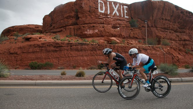 Ironman 70.3 St. George participants ride their bikes past St. George's iconic Sugarloaf on May 7 during the annual triathlon that draws competitors worldwide to the area. Local tourism officials report a strong majority of outdoor athletic event visitors say they are interested in returning to St. George to vacation.