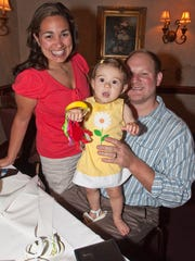 In this August, 2009, file photo, Beth DiBello, left, of Succasunna, with daughter Nicole, 1 year old, and husband Don at La Strada in Randolph.