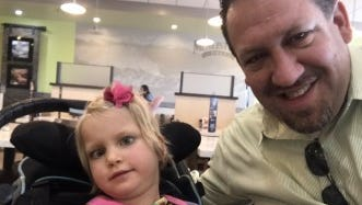 Rep. Jeremy Faison with Maggie Selmeski. Her family moved from Tennessee to Colorado when she was 2. She was having more than 500 seizures a day from an intractable epilepsy of unknown origin. Her medical costs in Tennessee were $20,000 a month. She is now almost seizure free and her cannabis-based drug prescription in Colorado is $50 a month.