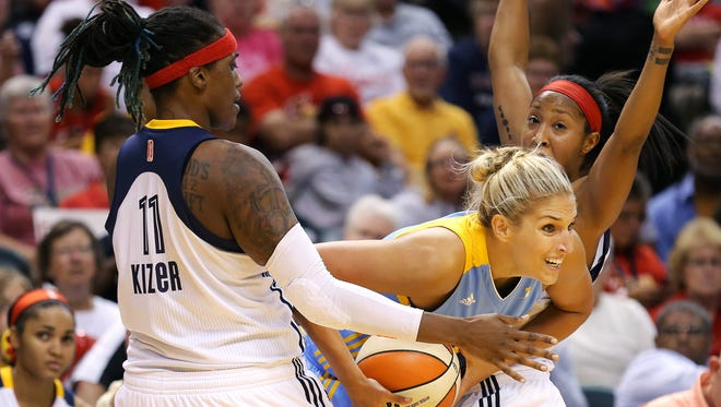 Chicago Sky forward Elena Delle Donne attempts to split the defense of the Indiana Fever.