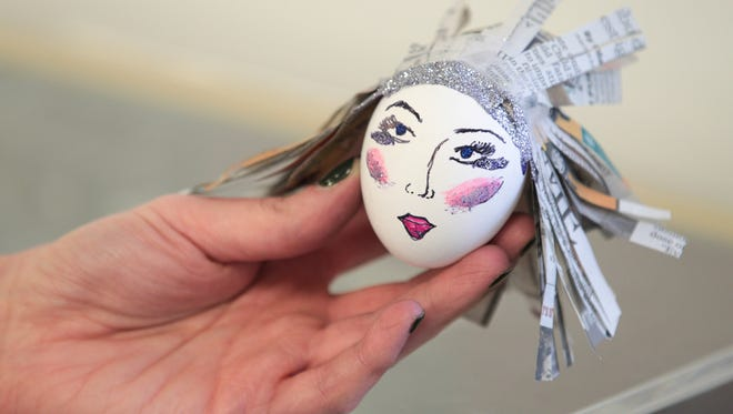 An egg designed by Amy Bartner for the Indianapolis Star features department's Egg Baby Parenting experiment, before Easter, Tuesday, April 8, 2014.