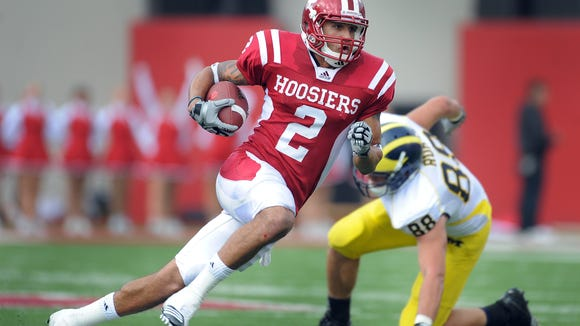 Indiana wide receiver Tandon Doss (2) runs by Michigan linebacker Craig Roh (88)in the second half of a 2010 game at Memorial Stadium in Bloomington.