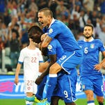 Mario Balotelli (L) celebrates with his teammate Leonardo Bonucci after scoring on a penality kick during the FIFA World Cup 2014 qualification match against the Czech Republic at Juventus Stadium in Turin on Tuesday. Italy won 2-1.