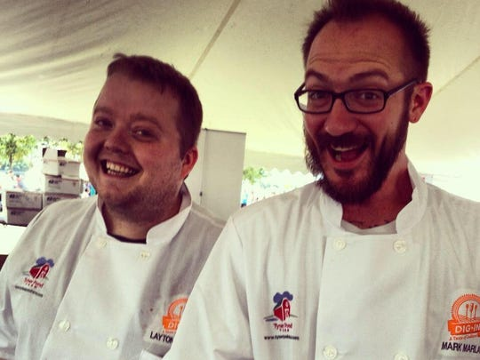 "When chef Layton Roberts (left) was too ill to work his station at the DigIN: A Taste of Indiana food festival one year, chef Mark Marlar (right) took over Roberts' duties. ""If you look close, I have a gray-green tint to my skin. Not a filter. I was sick as a dog,"" Roberts said. """"Needless to say, he saved the day,"" Roberts said of Marlar."
