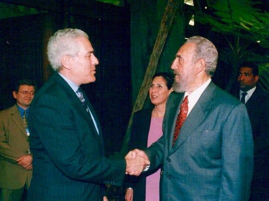57. University of Delaware professor and former CNN world affairs correspondent Ralph Begleiter with former Cuban president Fidel Castro in Havana, Cuba in 2002.