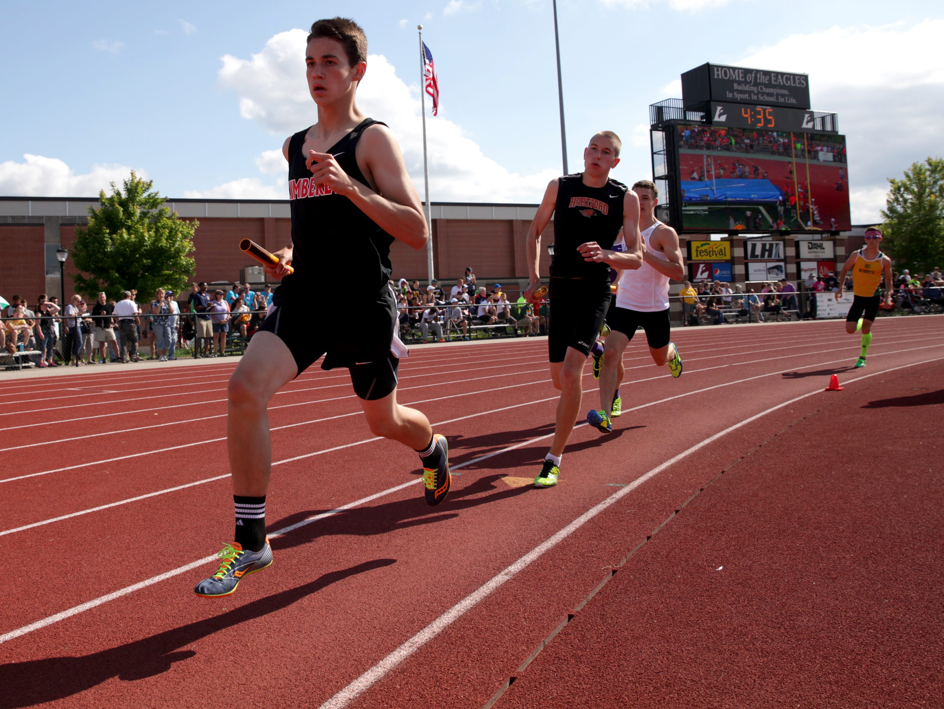 Evan Blom of Kimberly runs in the Division 1 3200-meter relay Friday during the WIAA state track and field meet at La Crosse.