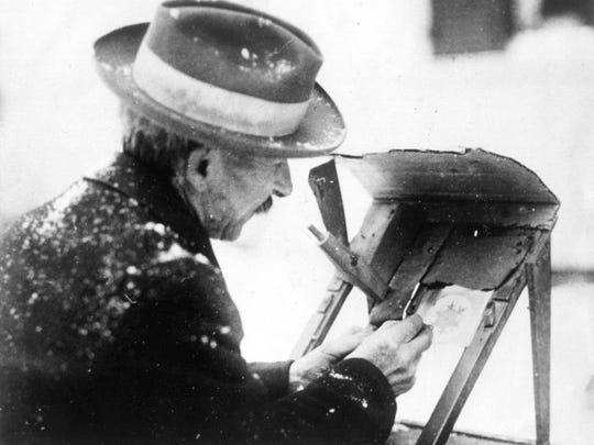 Wilson Bentley showing how he photographs snowflakes. This photo was taken around 1917.