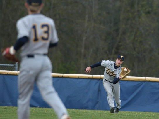 Victor left fielder Louie Schafer makes a running catch